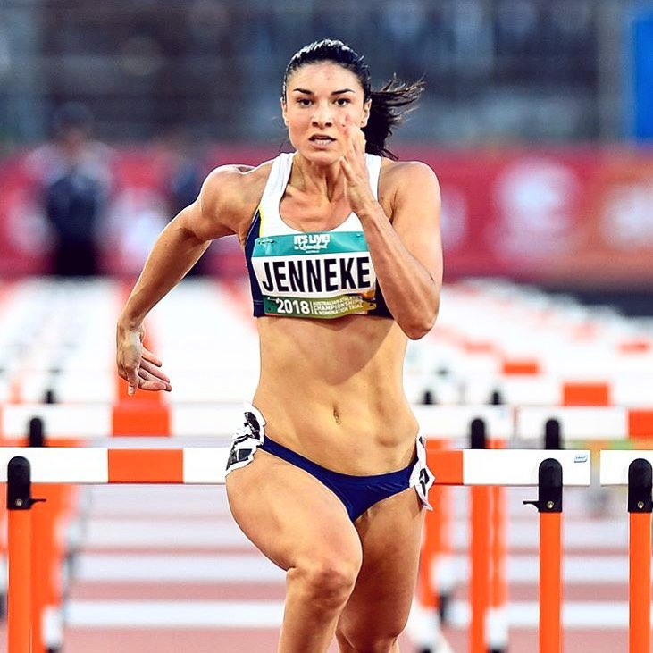 Michelle Jenneke sprinting during a competition, looking extremely focused