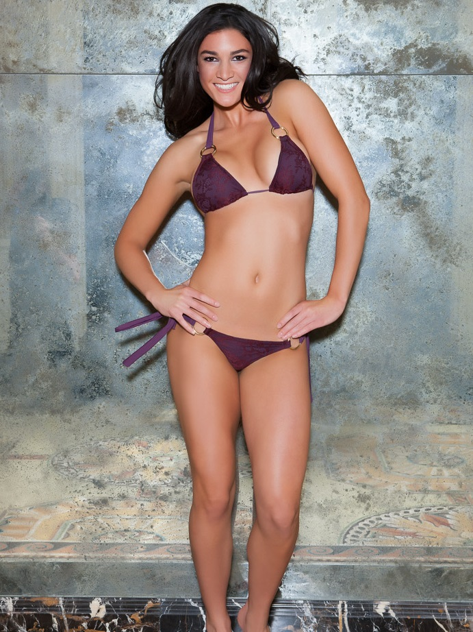 Michelle Jenneke posing in a bikini in a modeling photo shoot
