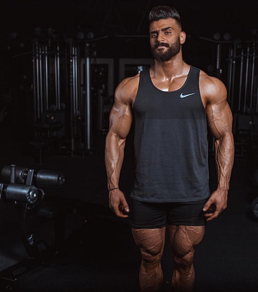 Mohamed El Qadi looking shredded in his sports tank top