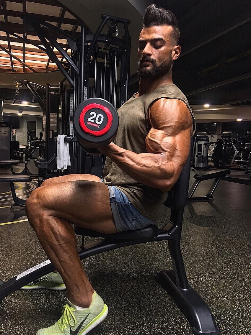 Mohamed El Qadi training arms in a gym