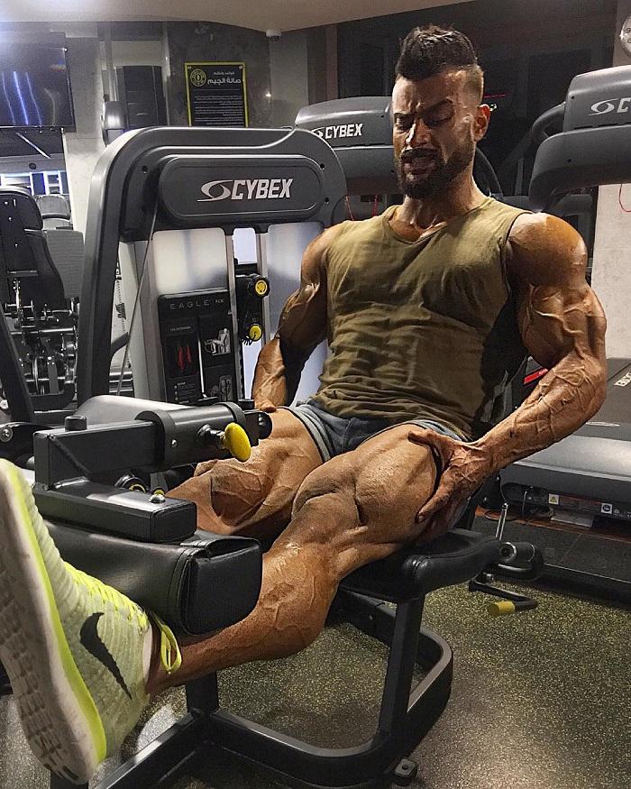 Mohamed El Qadi doing leg extensions