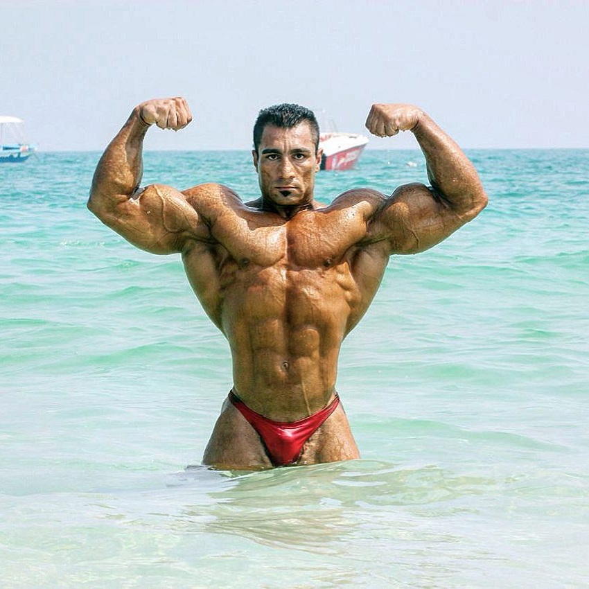 Rouhollah Mirhoseini doing a front double biceps flex in the sea