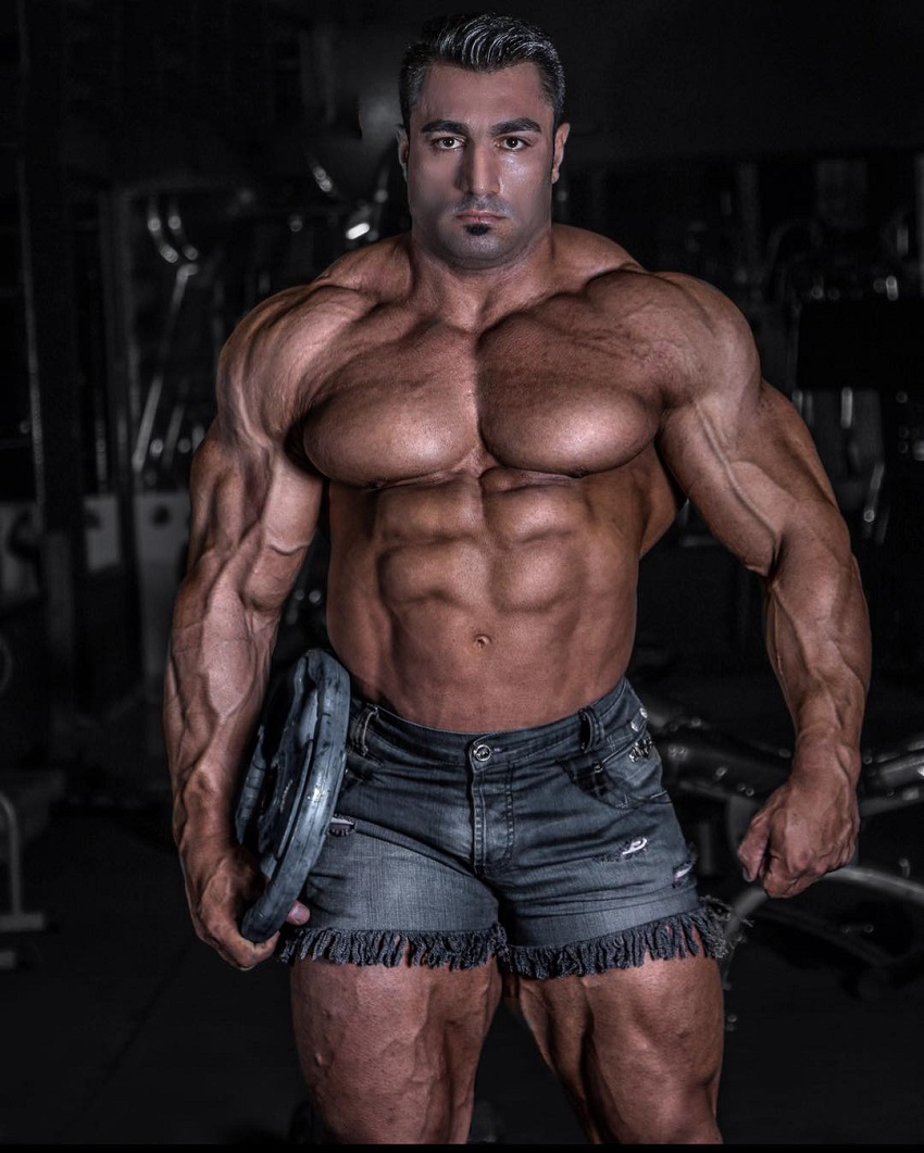 Rouhollah Mirhoseini showing off his ripped body in a photo shoot