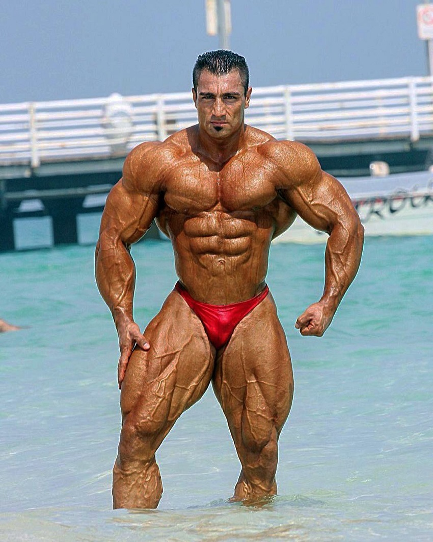 Rouhollah Mirhoseini standing in the sea looking vascular and ripped