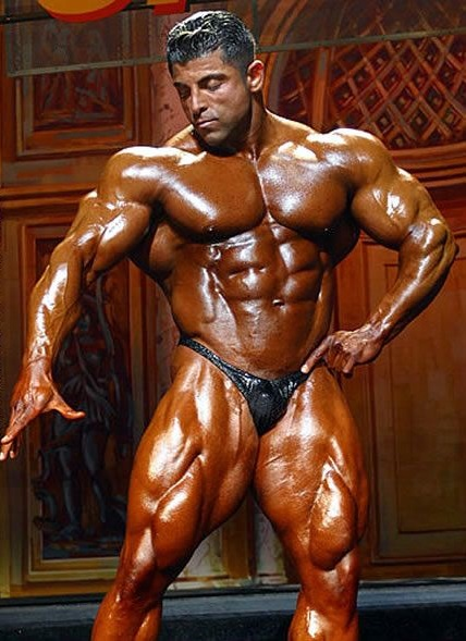 Shahriar Kamali showing off his immaculate physique in a bodybuilding contest
