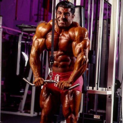 Shahriar Kamali doing heavy cable triceps pushwodnws