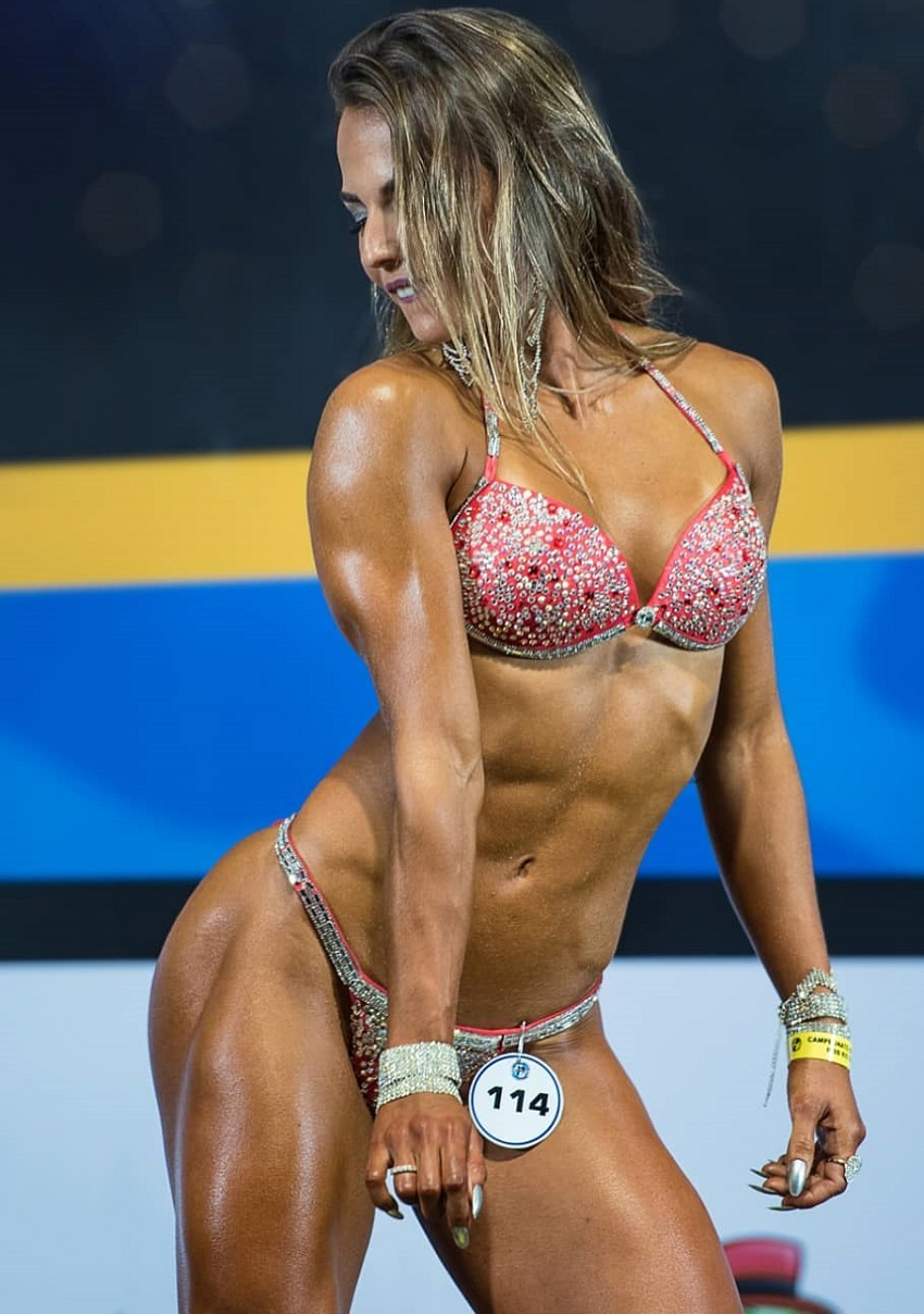 Vanessa Garcia performing a posedown on a wellness stage