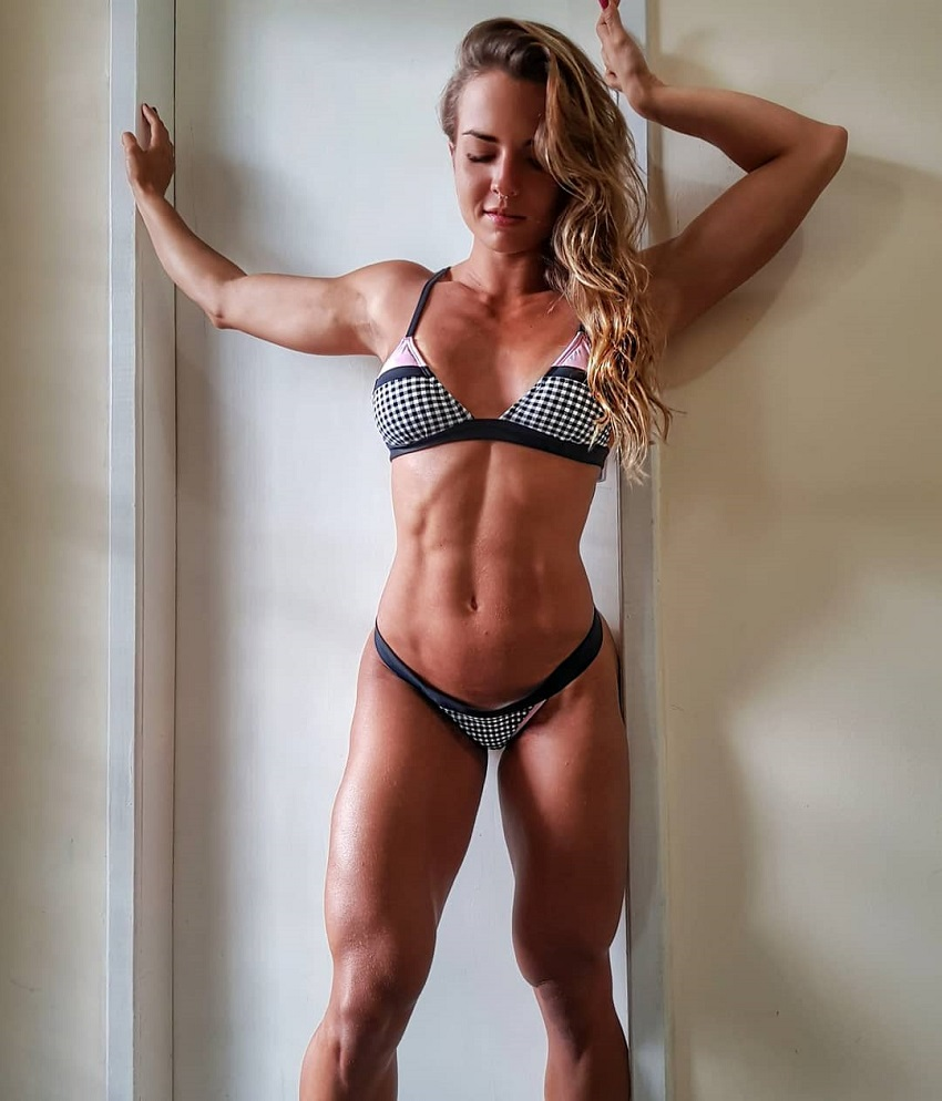 Vanessa Garcia standing in a room showcasing her toned and aesthetic body