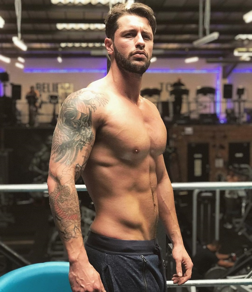 Vince Azzopardi posing shirtless for a photo looking lean and strong