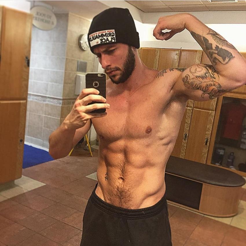 Vince Azzopardi flexing his bulging biceps in a selfie