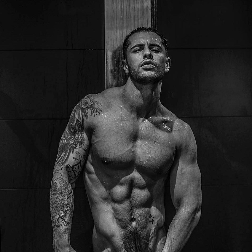 Vince Azzopardi posing shirtless in a photo shoot