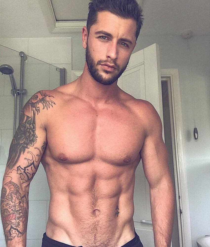 Vince Azzopardi posing shirtless in a bathroom