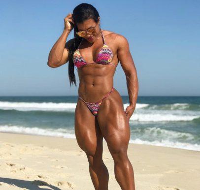 Alessandra Alvez Lima standing on the beach, showcasing her attractive body in a bikini