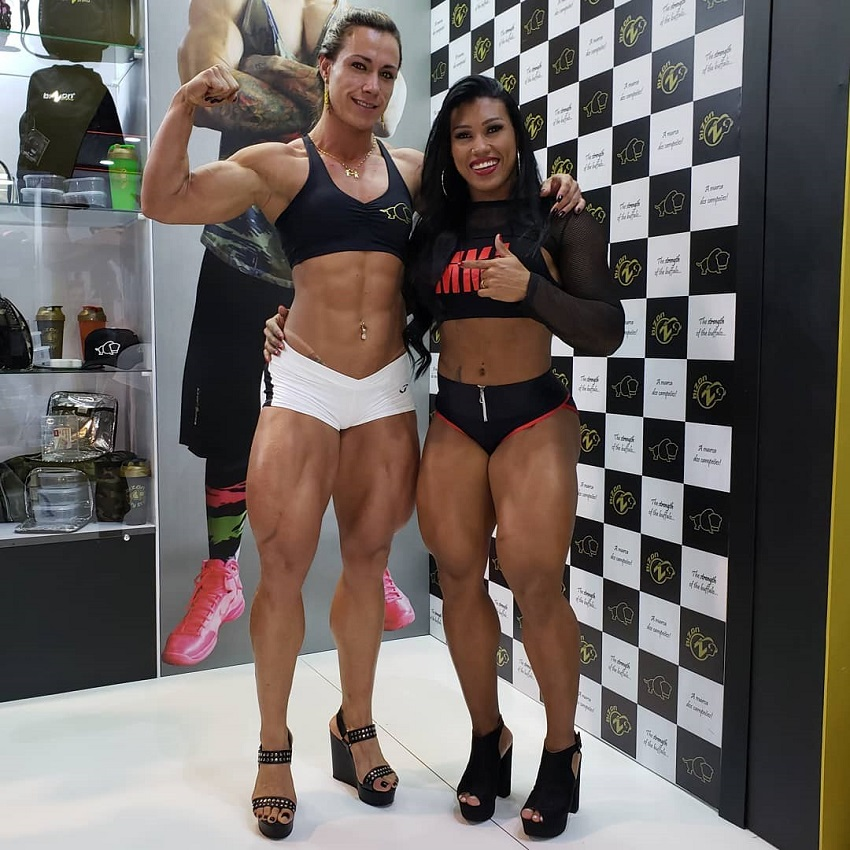 Carla Inhaia posing with Alessandra Alvez Lima, both looking strong and curvy