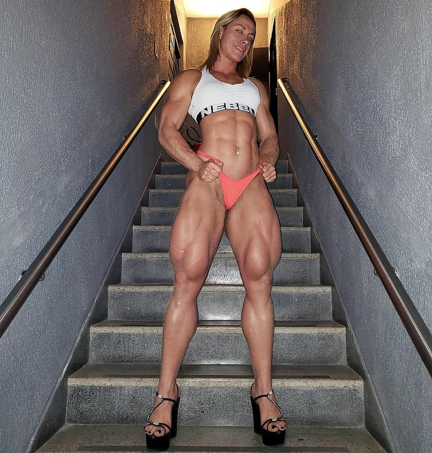 Carla Inhaia showcasing her ripped and toned legs while standing on the stairs