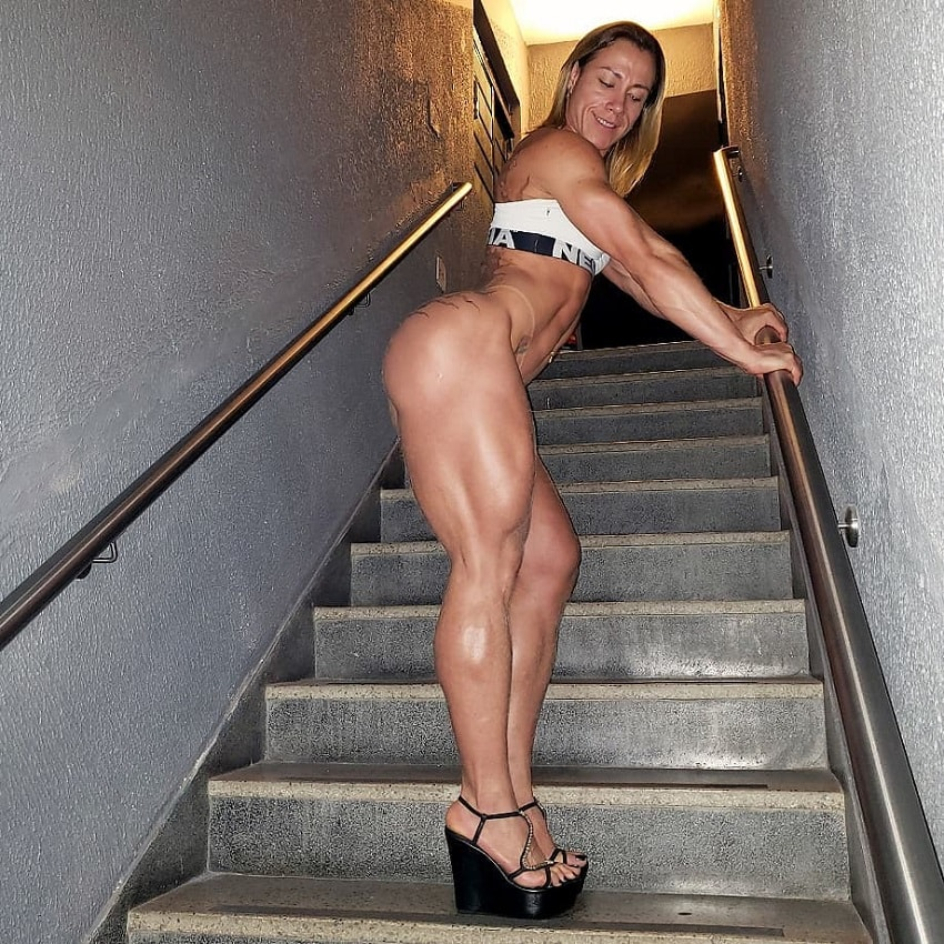 Carla Inhaia posing on stairs looking ripped and aesthetic