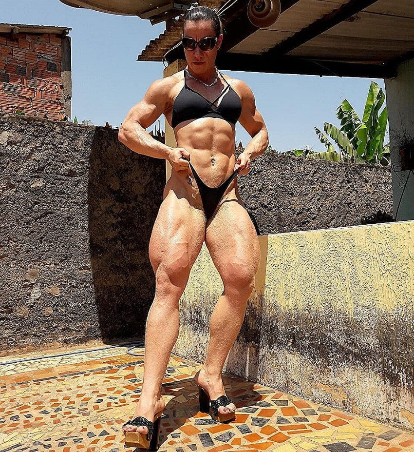 Carla Inhaia flexing her legs looking ripped and muscular