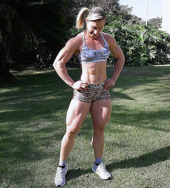 Carla Inhaia standing in grass looking curvy and toned