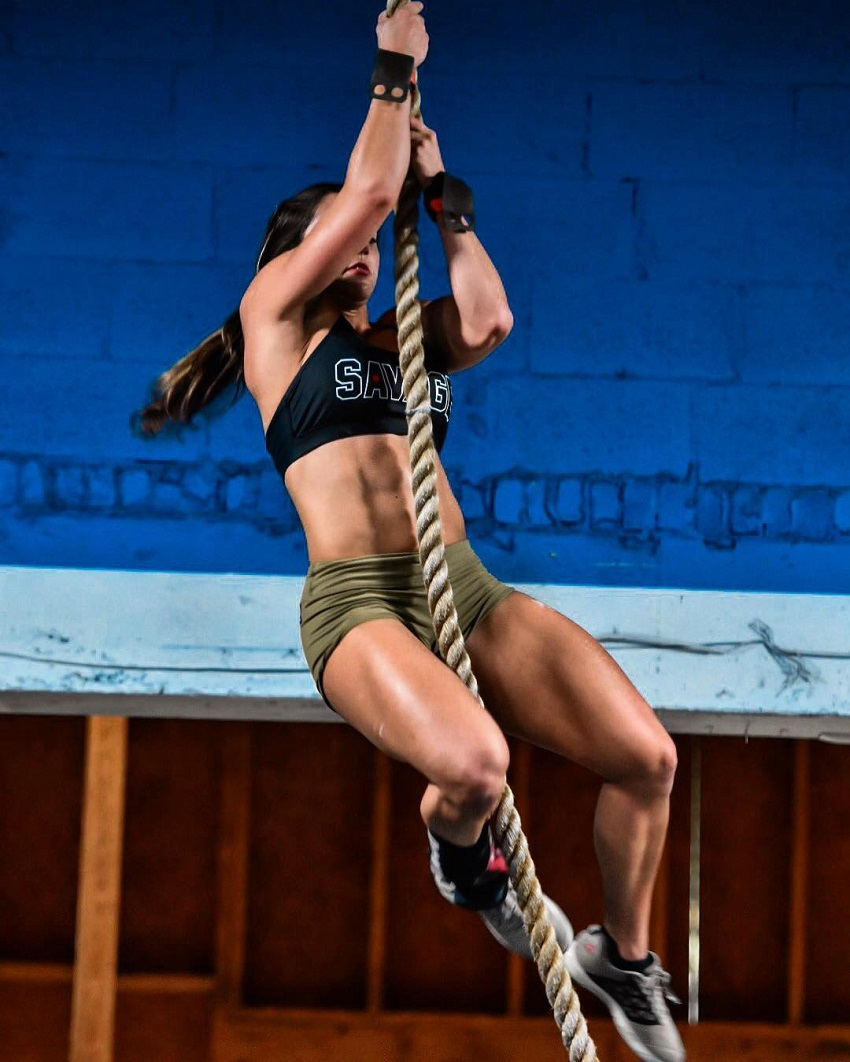 Cristina Bayardelle climbing rope, looking fit and lean
