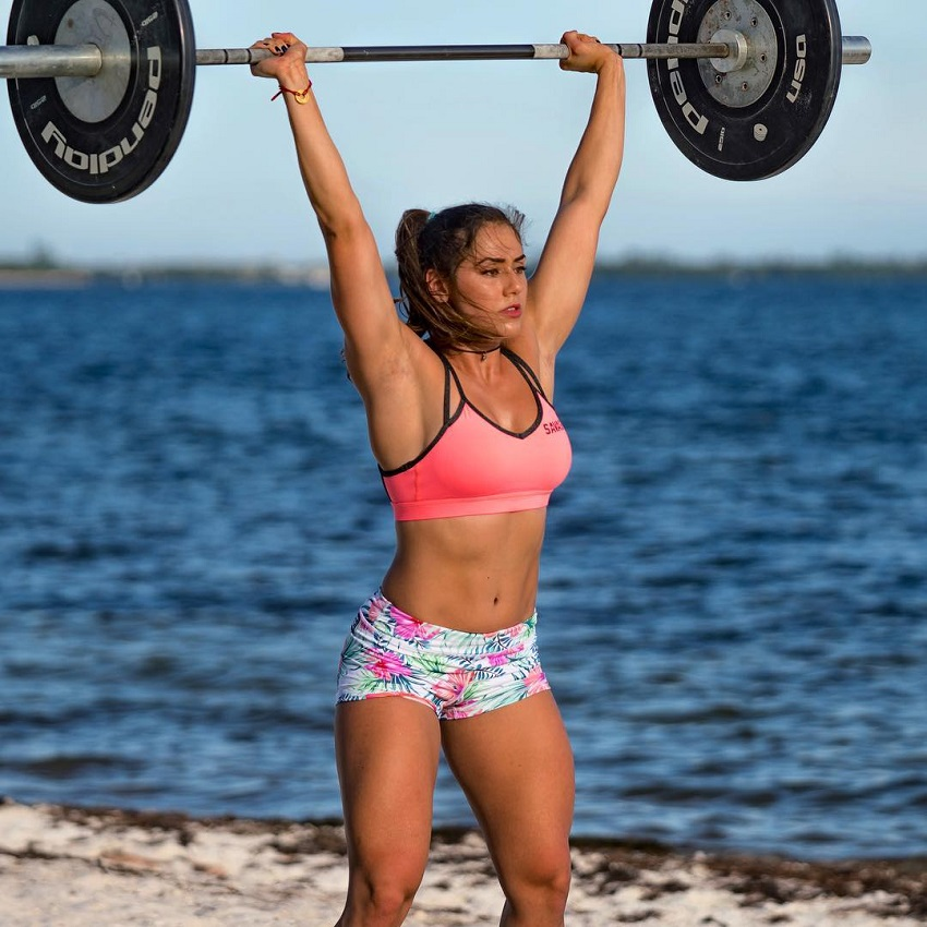 Cristina Bayardelle doing an overhead press looking fit and toned
