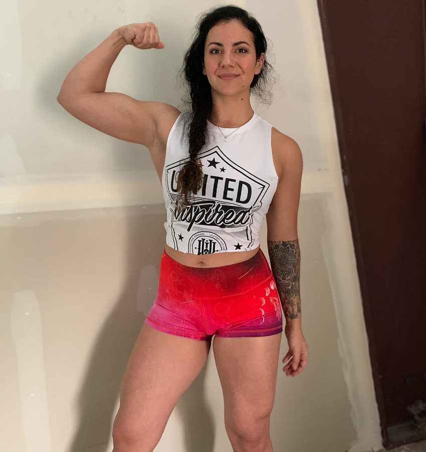 Gina Felice Aversa flexing her biceps for a photo