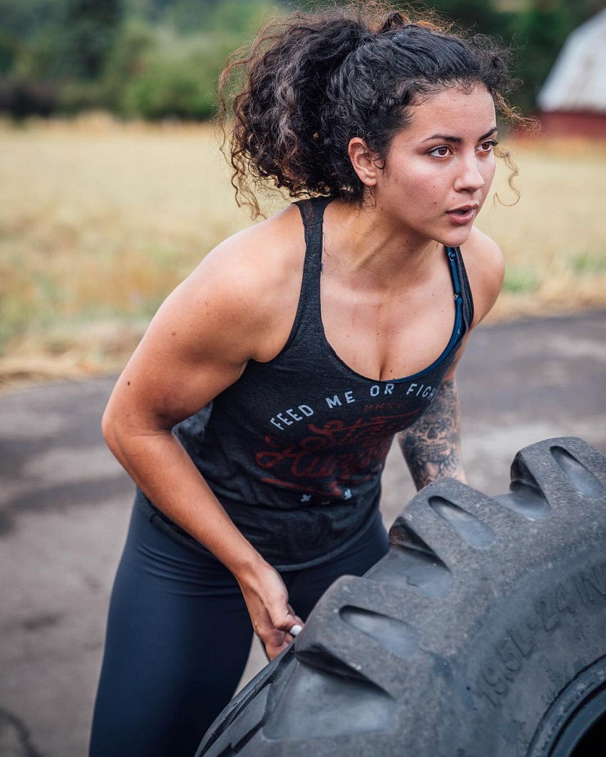 Gina Felice Aversa lifting a big and heavy tire