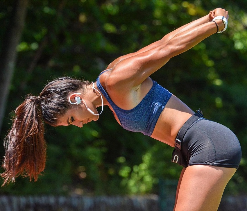 Heba Ali stretching outdoors looking fit and lean