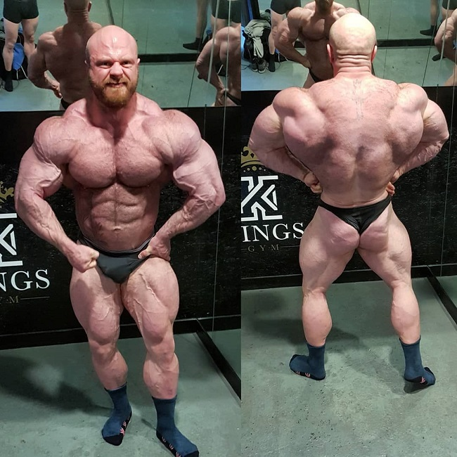 James Hollingshead posing shirtless for the photo, looking massive and conditioned