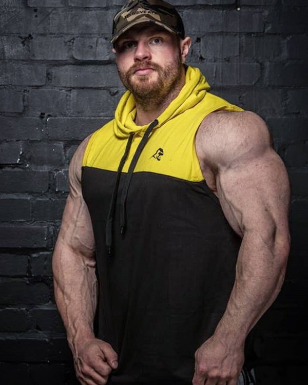 James Hollingshead posing for the photo in sportswear looking big and ripped