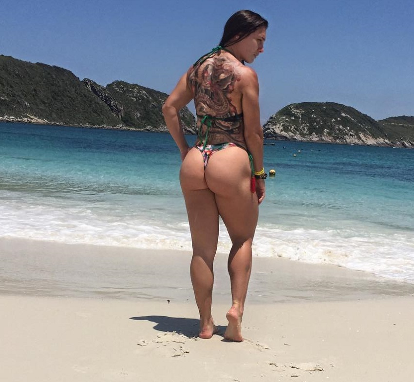 Kelly Karina showcasing her curvy glutes on a beach