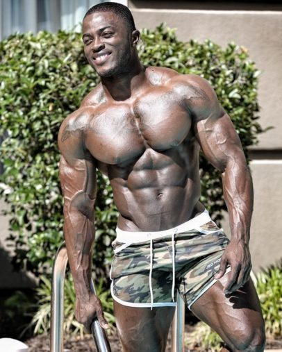 Kenneth Owens flexing shirtless looking huge and ripped