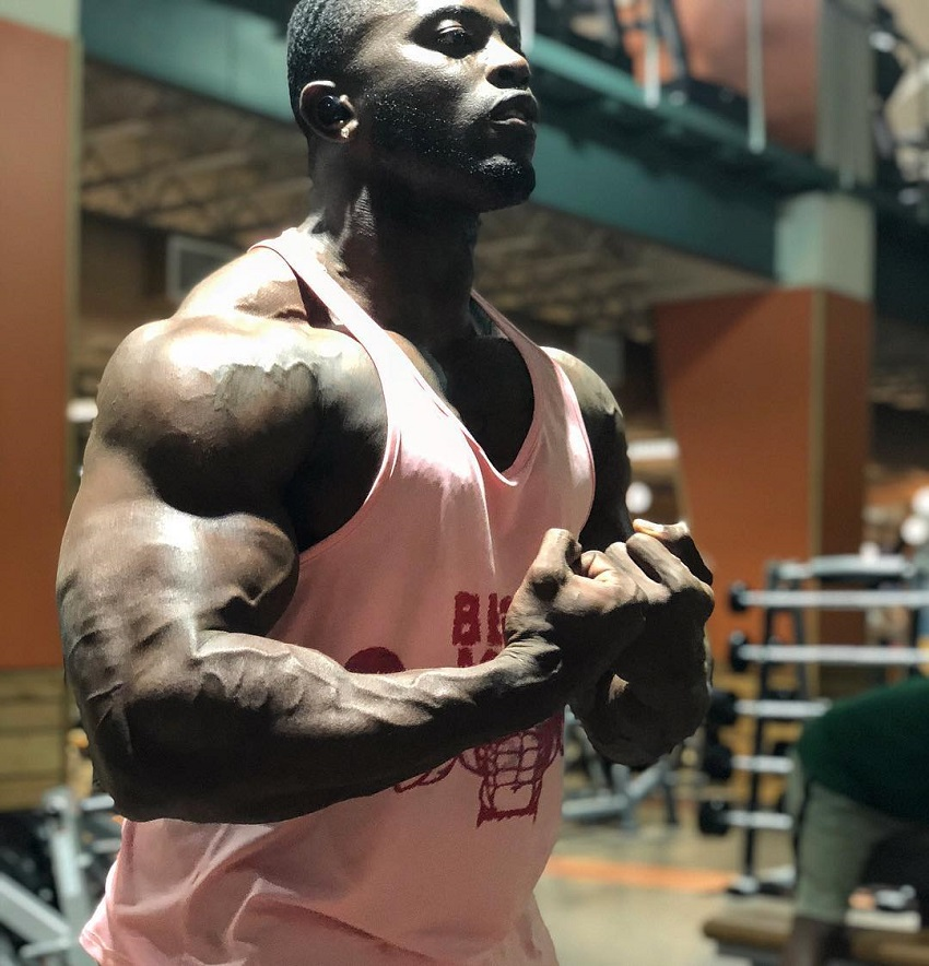 Kenneth Owens flexing for the photo looking big and ripped
