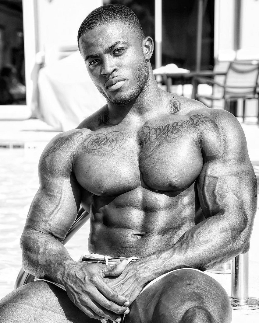 Kenneth Owens posing shirtless for a photo looking ripped and big