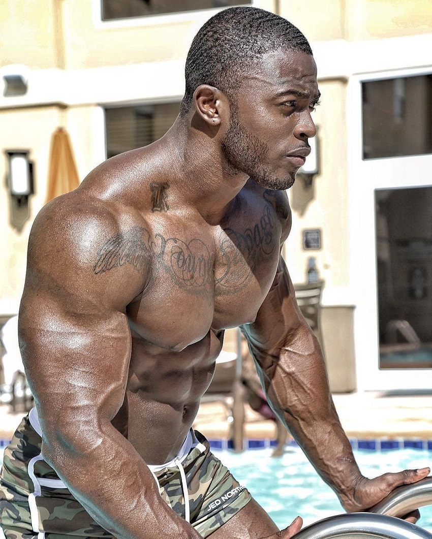 Kenneth Owens posing shirtless looking swole and ripped