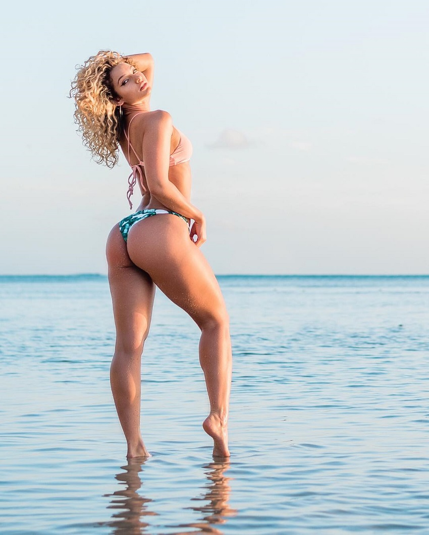 Lauren Wood posing in shallow waters looking curvy and fit