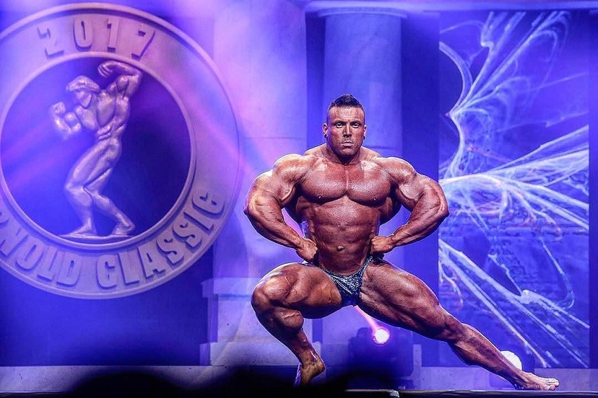Luke Sandoe performing a pose routine on the Arnold Classic Stage