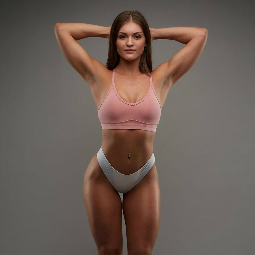 Maria Gad posing for a professional photo shoot, looking fit and lean