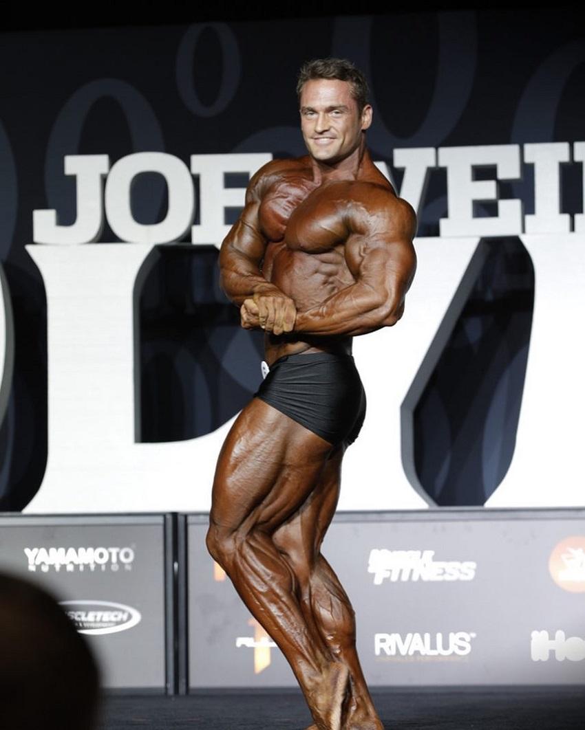 Stanimal De Longeaux posing on the Olympia stage