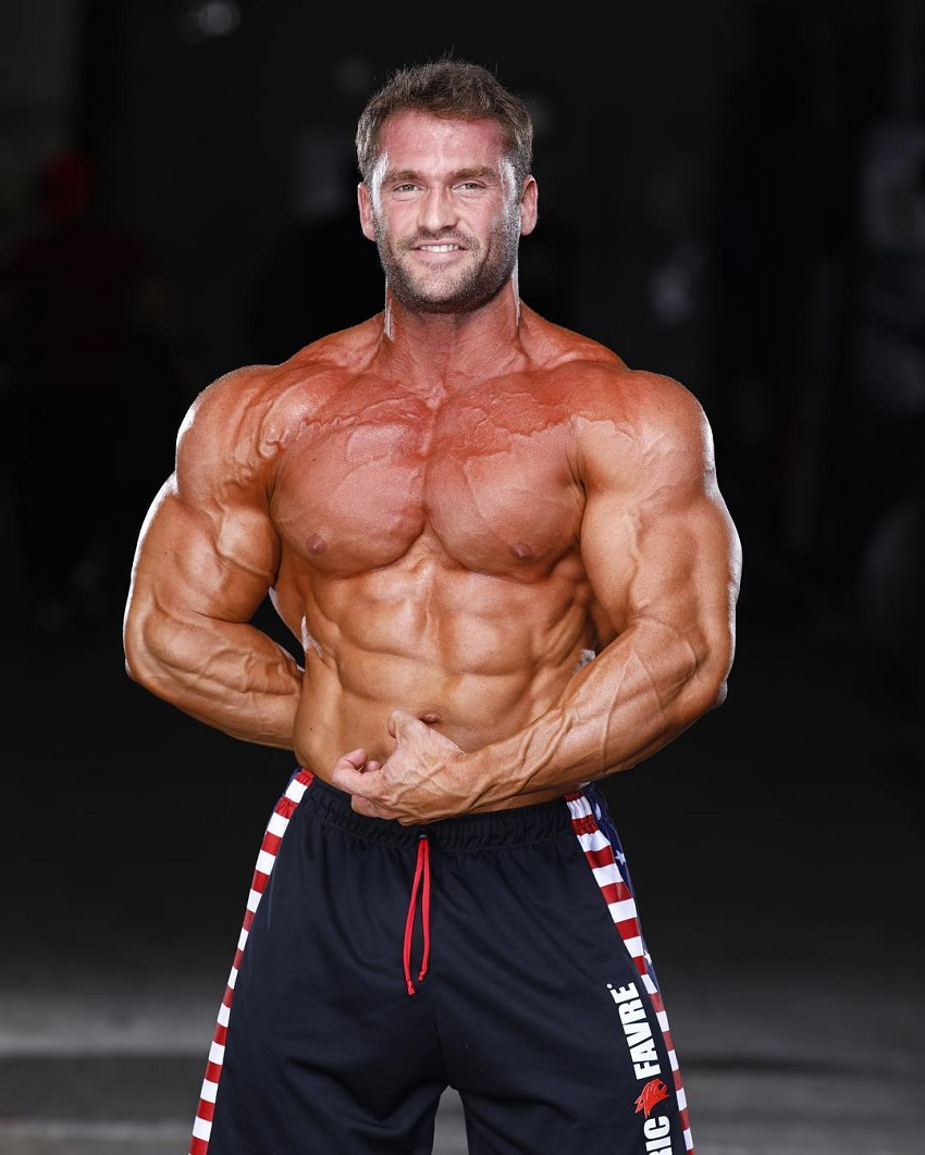 Stanimal De Longeaux flexing his swole and ripped muscles for a photo