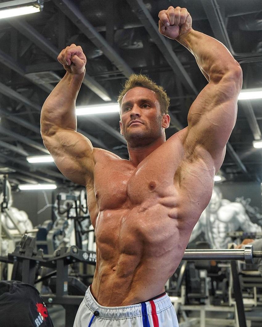 Stanimal De Longeaux posing shirtless in a gym