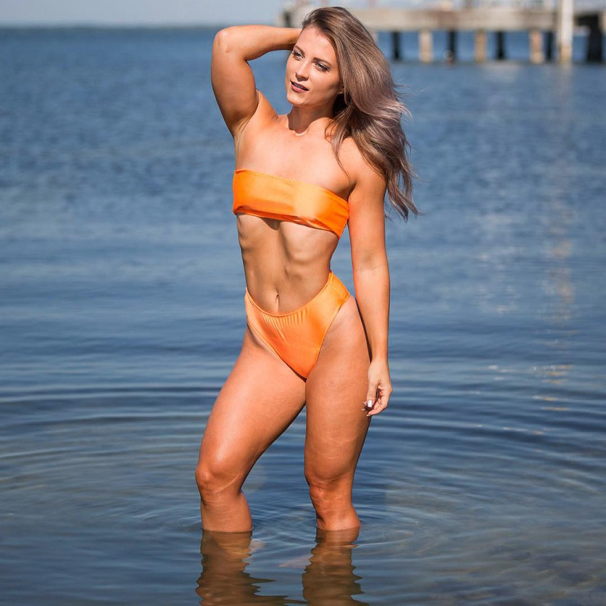 Taylor Brown standing half-way in sea looking fit and lean
