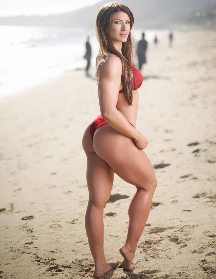 Taylor Spadaccino showcasing her toned legs and glutes on the beach