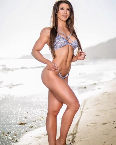 Taylor Spadaccino posing on the beach looking fit and lean