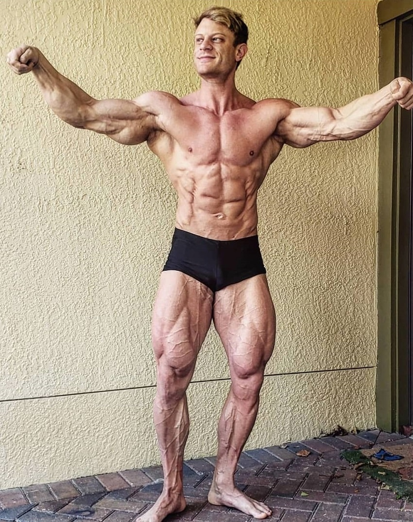 Tyler Garceau flexing his muscles for a photo