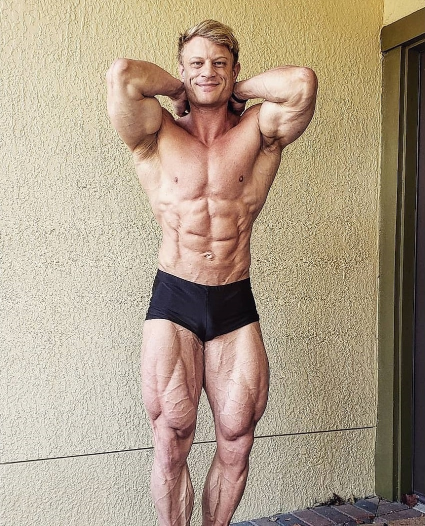 Tyler Garceau showcasing his ripped abs and legs for a photo