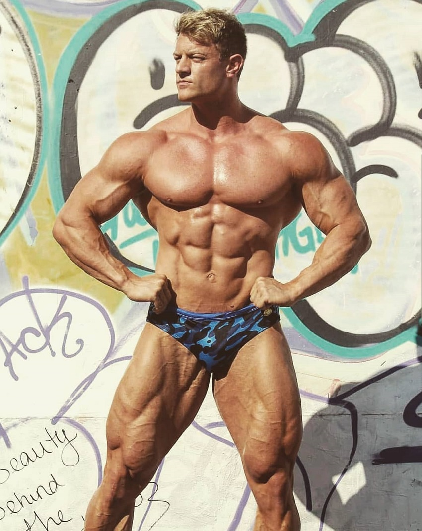 Tyler Garceau flexing outdoors looking ripped
