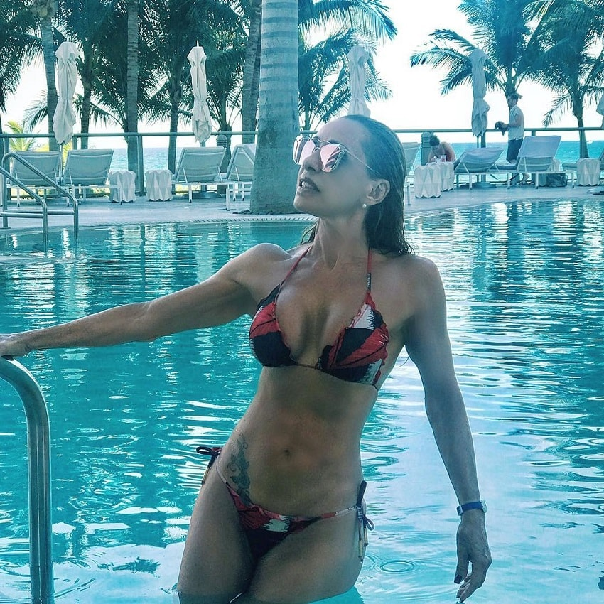 Adriana Miranda getting out of a pool looking fit and lean