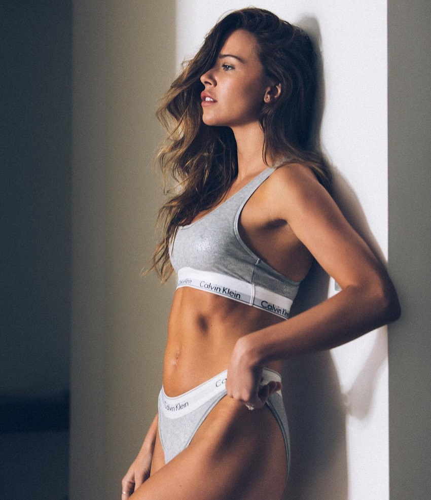 Alex Finch-Collison leaning against the wall looking fit and lean