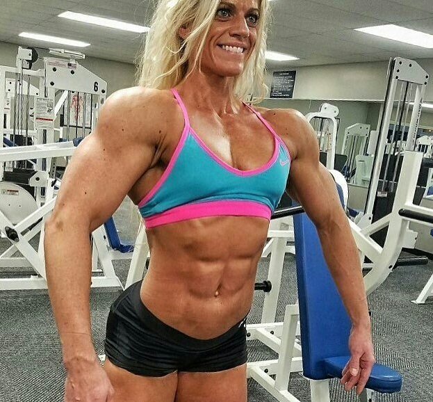 Autumn Swansen posing in front of the camera in the gym