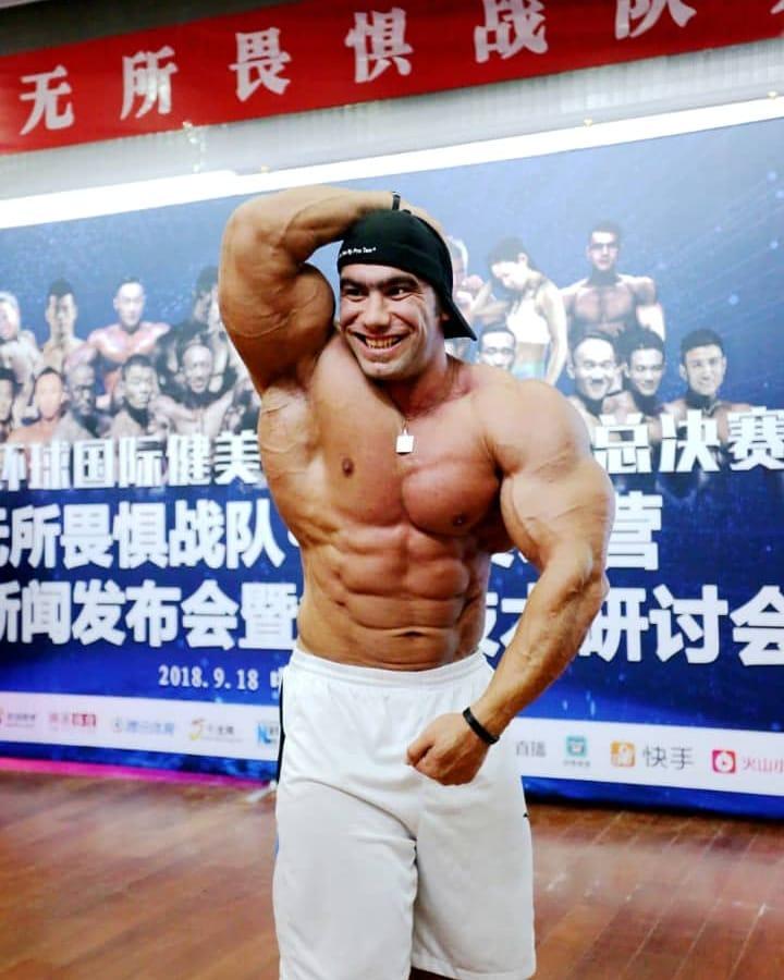 Ayat Bagheri flexing his bulging abs for the camera
